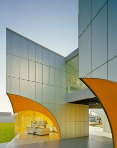 Take a bite. Concave orange void.  Nestle Querétaro - Rojkind Arquitectos - México