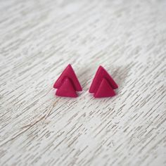 Magenta stacked triangle polymer clay stud earring  https://www.etsy.com/listing/384992022/magenta-stacked-triangle-polymer-clay