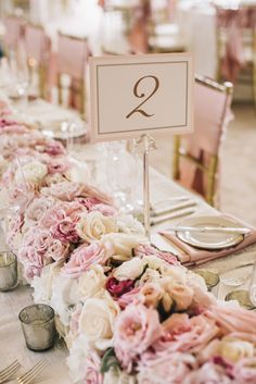 #Pink Roses   #Centerpiece   See the wedding on #SMP Weddings    http://www.stylemepretty.com/texas-weddings/austin/2013/12/11/traditional-austin-wedding/  SMS Photography