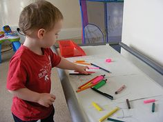 A super simple activity for all ages - a coffee table, some scrap paper and a box of crayons, and just let your little one scribble or draw away!       Mark making is a great development activity for many things including writing, drawing, creativity, fine motor skills, coordination, colours and shapes and dexterity.