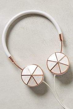 Holy shit I need these please Interchangeable Enamel Headphone Caps #anthropologie