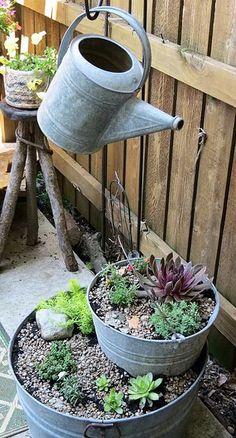 Watering the Succulent Bucket Tower