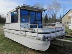 The Boathouse: a new definition to lakefront living! Pontoon Houseboat, Pontoon Boat, Houseboat Living, Jon Boat Trailer, Trailer Plans, Duck Boat Blind, Flat Bottom Boats, Runabout Boat, Remote Control Boat