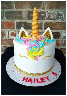 Rainbow unicorn birthday cake by Max Amor Cakes.