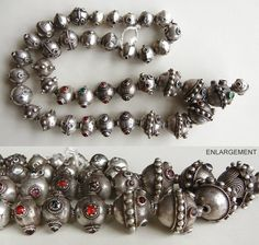 This is a gorgeous silver antique Afghani strand from the Kuchi people. It includes beads decorated with glass gems as well as other decorations.