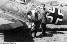 German pilot preparing for a mission in front of his Bf 109 fighter, North Africa, 1941 Photographer Loßnitzer Source German Federal Archive Identification Code Bild Added By C. Luftwaffe, Me 109, Aircraft Photos, Ww2 Aircraft, Military Jets, Military Aircraft, The Spitfires, Afrika Korps, Ww2 Planes