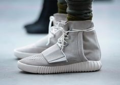 Kanye West debuts first Adidas collection and Yeezy trainer.