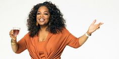 Oprah Winfrey in an orange shirt.