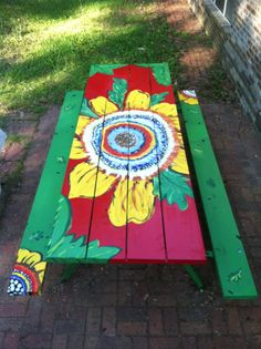 This is my recreation of a table I saw on Pinterest. My dad and I built the picnic table and I painted it!