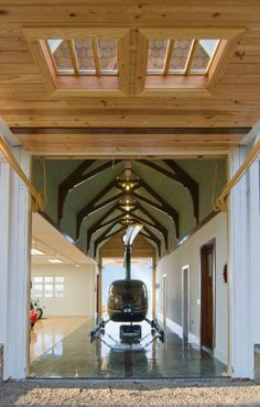 Parking space for his helicopter is provided by a long and high center concourse area. Auckland, Mansion Interior, Carriage House, Dream Garage, First Home, Log Homes, Custom Homes, Gazebo, House Plans