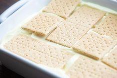 graham cracker eclair cake in pan No Bake Eclair Cake, Eclair Cake Recipes, Eclair Recipe, No Bake Desserts, Easy Desserts, Dessert Recipes, French Desserts, Dessert Ideas, Cafeteria Food