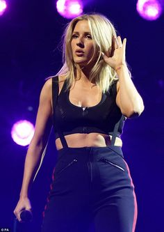 Rocking out: Ellie Goulding flaunted the fruits of her exercise labour as she put on an energetic display during a gig in London on Saturday night