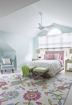 The daughter's room conveys a feminine vibe, with a flowered rug and bedding from PBteen.