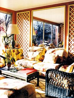 Sunroom with lattice, mirror, botanical fabric, wicker - C.Z. Guest's Templeton, decorated by Stéphane Boudin (and later Paul Manno) of Maison Janson - House & Garden, June 2004