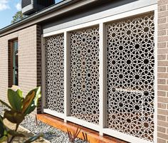 use stamped tin in garden   ... your outdoor space with designer metal screens, firepits and wall art
