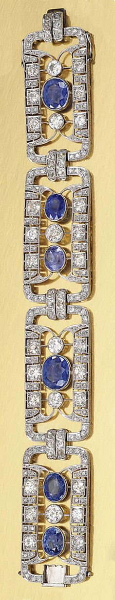 SAPPHIRE AND DIAMOND BRACELET, 1930S.  Designed as a series of open work geometric plaques, set with circular- and single-cut diamonds, highlighted by oval sapphires, length approximately 195mm.