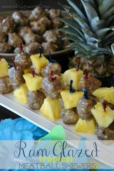 Rum Glazed Meatball Skewers- Tropical meatballs with #coconut and #pineapple in a delicious #captainmorganrum glaze! #captainholidays @Liting Sweets