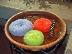 Butterfly feeder: terra cotta pot bottom filled w/ butterfly nectar and colorful scrubbers