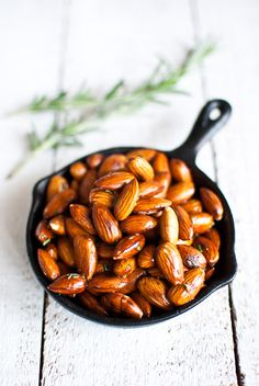 Rosemary roasted almonds  (Recipe adapted from Melissa Kelly)    1 cup raw almonds  few sprigs of fresh rosemary   2 tablespoons fresh rosemary, finely chopped, extra  2 tablespoons good extra-virgin olive oil  pinch of sea salt  freshly ground black pepper