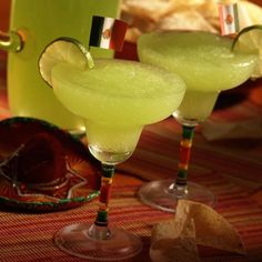 Classic Margarita (1 can of frozen Bacardi Mixers Margarita, 1/2 cup of Bacardi Rum, 5 cups of ice and limes for garnish)