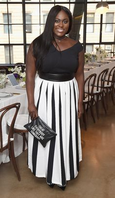 Danielle Brooks in a black top and pleated black-and-white maxi skirt