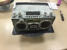 "Retro stereo cake from the top. The final product had this on top of a full sheet cake with a graffiti ""happy birthday"" sprayed on but I forgot to take a pic :("