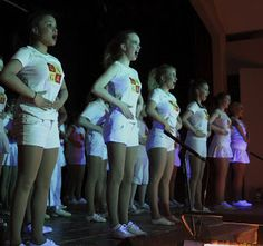 The Old Button Costumes - WWRY Part 1 - Radio Ga Ga  We Will Rock You Ga-Ga kids in white t-shirts and shorts