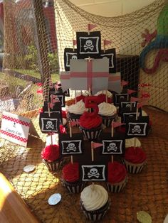 Cool cupcake ship at a pirate birthday party! See more party planning ideas at CatchMyParty.com!
