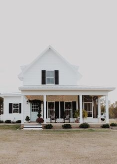 Modern farmhouse exterior with black shutters and major curb appeal. Charming house ideas, dream house exteriors, dream homes, white houses, modern farmhouse ideas