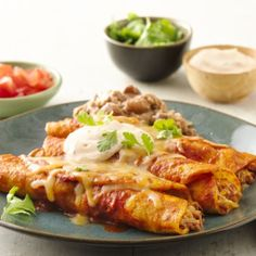 Seasoned sour cream and refried beans make these a complete, easy meal!