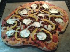 Vegan - Pizza with fake meat, zucchini, yellow pepper and onion.