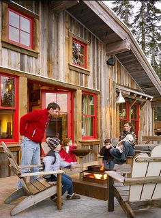 """A beautiful family enjoying their dreamy cabin.  The deck has a snowmelt system. No shoveling!  Trim Paint Color: """"Benjamin Moore 2003-10 M..."""