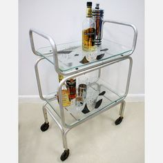 A Bar Cart! Portable drinks...from kitchen, to livingroom, to toilet. Awesome.