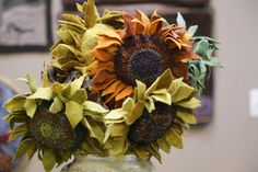 Hooked and proddy wool sunflowers made by Joanne Gerwig