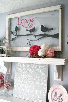 love the bird decal on the old window in coral and gray with babys name!  and the pom poms
