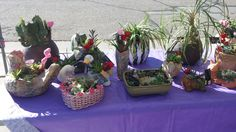 Wide variety of hand painted, crafted, and refurbished pots and arrangements are available to purchase!