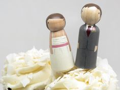 Peg People DIY Kit Custom order a set of these peg dolls to be a perfect match of you and your betrothed. They are hand-painted with non-toxic paint. For those who would like to create their own custom peg doll, Goose Grease offers DIY cake topper kits.