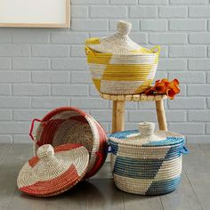 Stash hand towels or spare TP rolls in a colorful catchall. Ones that caught our eye: These printed woven baskets, about $59, from westelm.com