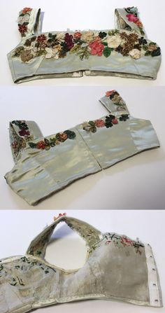 "regency Silk Satin Evening Bodice with Silk Flowers, circa 1800-1820 via eBay | Measures: n/a From the seller: ""MET Museum Deaccession...Constructed with pale green satin and decorated with fabric flowers. There is a hook and eye closure at the back. Most likely British."" Hook and eye tape added later by machine, probably during the Edwardian era."