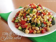 Corn & Chickpea Fiesta Salad with Cilantro Lime Vinaigrette Recipe Salads with corn kernels, garbanzo, cherry tomatoes, green bell pepper, purple onion, english cucumber, extra-virgin olive oil, fresh cilantro, lime juice, garlic, salt, pepper