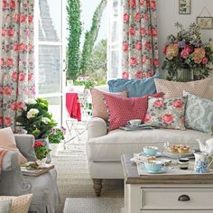 Bring the garden indoors. Use dashes of decorative pattern in pinks, soft greys and pretty blues to add cheer to white walls. Choose curtains in modern vintage florals and a sofa with a simple shape for a clean, upbeat feel...