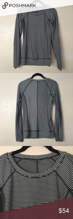 Lululemon long sleeve Lululemon black and white striped long sleeve. Features thumb holes and a zippered pocket on the back. In EUC; worn 5-6 times and has no flaws. Reasonable offers welcome lululemon athletica Tops