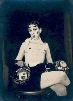 LOVE. Claude Cahuns Self-Portrait (as weight-trainer) from 1927. Her shirt reads, I am in training. Dont kiss me.