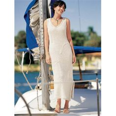 V-Neck Resort Dress  V-Neck Resort Dress  Design by Mari Lynn Patrick  Get swept away in this long, lean stunner featuring a reverse-stockinette-stitch body with triple knit-in loops. A deep V-neck, shaped side seams and slits make for a flattering fit Pattern