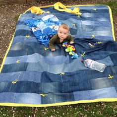 Old jean picnic quilt! Lining is 5$ Walmart vinyl tablecloth to keep moisture from coming through. Little yellow bows really add a cute touch.