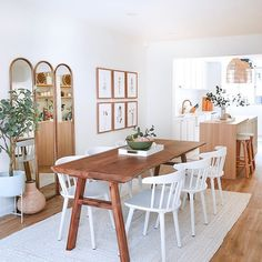 Dining area feels empty? Use a big area rug to anchor the space! Choose a colour and texture that complements the overall look and feel of your home, and don't forget to complete your walls to add character to your space! 🤗  -  Designed and styled by Jade