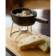 "Martha from The Black Forest says, ""We love these baby skillets! We've used them for fondues, warm dips, and our latest small plate, meatballs. customers love the presentation. They are easy to maintain and are super durable. The stand is from Webstaurant too!"""