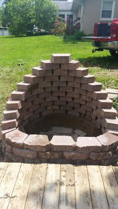 My beautiful new fire pit my husband and I built.  Used Crestone II retaining wall blocks  in Autumn Blend  3 1/2H x 11 1/2W x 7D. I think it was around 76 blocks.