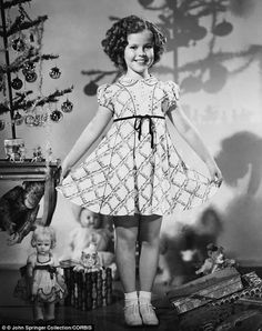 Pretty as a present: Shirley Temple modeled a new Christmas dress in this 1935 photo