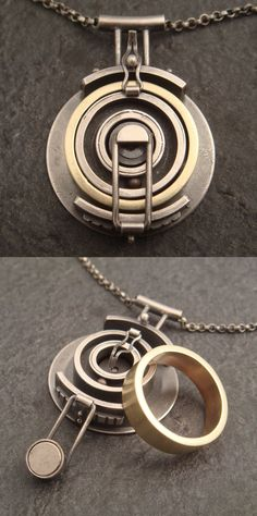 Pendant | Chuck Domitrovich. 'Wedding Ring Holder'.  Sterling silver with one brass ball bearing as an added kinetic element.  This ring was a custom order by a doctor's wife who wanted that her husband had a secure place to keep his ring, when he went into surgery and had to scrub in.